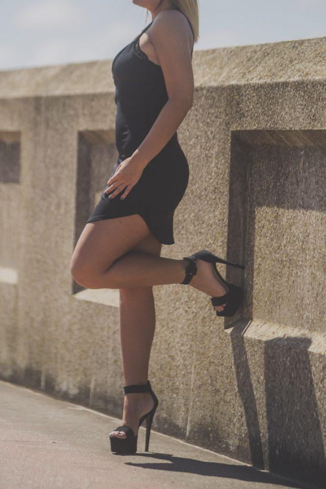 busty preston escort, blonde, black dress